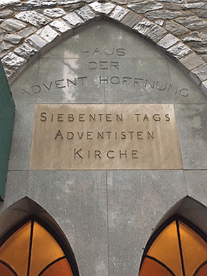 Church sign on building wall